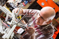 Workman making mailbox plate in workshop Royalty Free Stock Photos