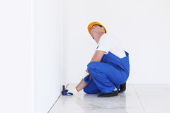 Workman measeres height Stock Photos