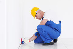 Workman measeres height Stock Image