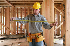 Workman Measuring Stock Photo