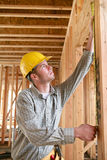 Workman Measuring Stock Image