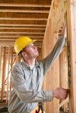 Workman Measuring Stock Image
