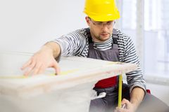 Workman measuring bathtub Stock Photo