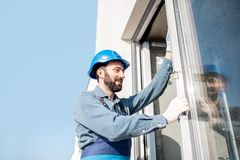 Workman mounting windows stock images