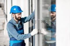 Workman mounting windows stock photos