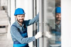 Workman mounting windows stock image