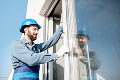 Workman mounting windows royalty free stock images