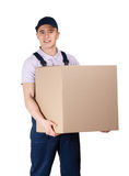 Workman in overalls hands a big parcel. Isolated on white. Transportation service Stock Image