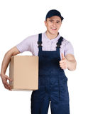 Workman in overalls hands a box Royalty Free Stock Photography