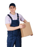 Workman in overalls hands a parcel Stock Photo