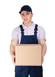 Workman in overalls keeps a parcel box Stock Photos