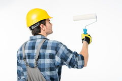 Workman with paint roller Stock Photography