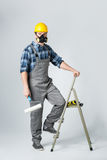 Workman with paint roller Royalty Free Stock Images
