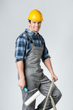 Workman with paint roller Stock Images
