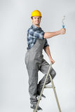 Workman with paint roller Stock Image