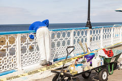 Workman painting seaside pier Royalty Free Stock Photo