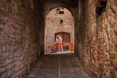 Workman. Perugia, Italy, May 13, 2013. Workman laying electrical cable in the old township of Perugia, Italy Royalty Free Stock Photography