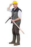 Workman with pickaxe Stock Images