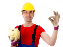 Workman with piggy bank. Making a good job Stock Photography