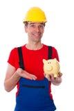 Workman with piggy bank Stock Photos