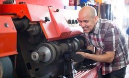 Workman polishing boots in workshop Stock Photo