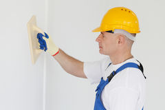 Workman polishing wall. Portrait of workman polishing wall Stock Photos