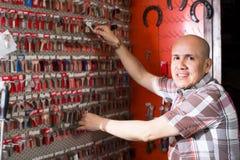 Workman posing with door keys Stock Photo