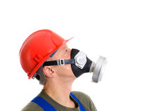 Workman with red hard top and protecting mask. Young workman with red hard top and protecting mask Stock Photo