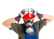 Workman with red hard top and protecting mask Royalty Free Stock Photos