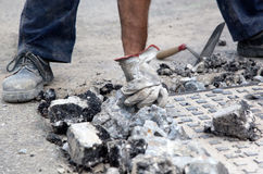 Workman removing rubble Stock Image