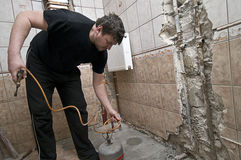 Workman renovating bathroom Royalty Free Stock Photo