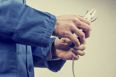 Workman repairing an electric cable Royalty Free Stock Photos