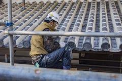 Workman repairing the Himeji Castle Stock Photo