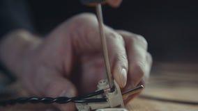 Workman repairing plug, jack, adapter plug with a screwdriver. Stock Image