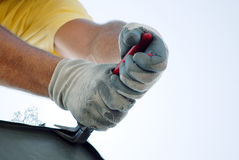 Workman repairs house Stock Photography