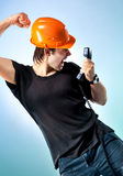 Workman screaming on phone. On soft blue background Royalty Free Stock Images