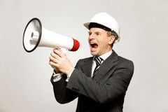 Workman Shouting Through Megaphone Royalty Free Stock Images