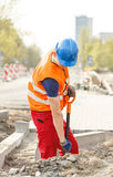 Workman with a shovel Stock Photography