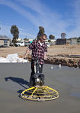 Workman smoothing newly poured concrete Royalty Free Stock Photo