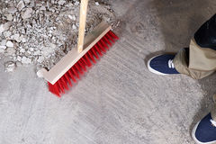 Workman sweeping the rubble on the floor with a broom. Workman sweeping the rubble on the floor with broom Royalty Free Stock Photography