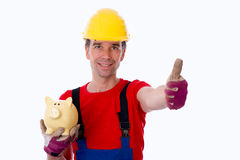 Workman with thumb up and piggy bank. Workman with thumb up is showing a piggy bank Stock Images