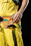 Workman in tool belt Stock Photography