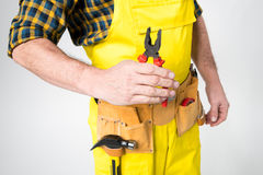 Workman with tool belt Royalty Free Stock Images
