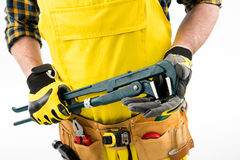 Workman with tool belt Stock Images