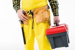 Workman with tool kit. Partial view of workman holding tool kit on white Stock Photo