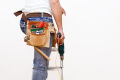 Workman with tools. And drill climbing ladder Stock Photography
