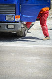 Workman and truck. Workman getting into a dirty blue truck Stock Photography