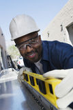 Workman Using A Level Stock Image