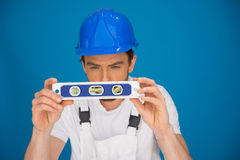 Workman viewing a spirit level Stock Photos