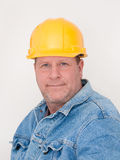 Workman. Wearing hardhat and jean jacket. White background Stock Images